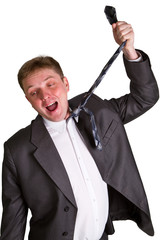 mid-adult man pulling necktie out to choke himself while making