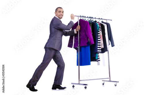 Businessman with rack of clothing