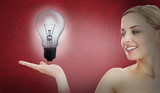 Smiling woman with light bulb inside her hand