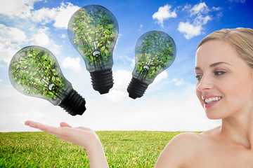Attractive woman with three light bulb
