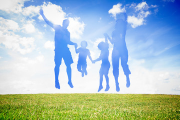 Silhouette of family jumping in the air