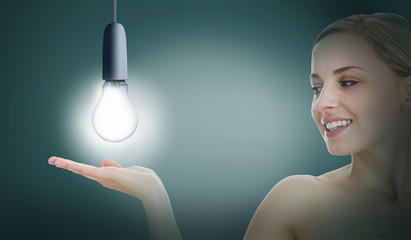 Woman presenting light bulb