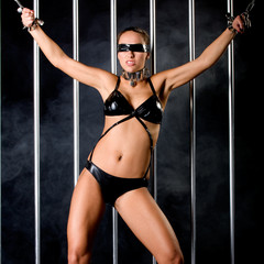 beautiful woman in lingerie in bondage style