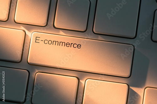White keyboard with close up on e-commerce button