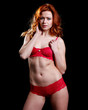 very beautiful woman with red hair in sexy red lingerie