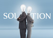 Business people with light bulbs for heads and solution text