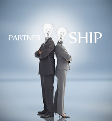 Business people with light bulbs heads and partnership text