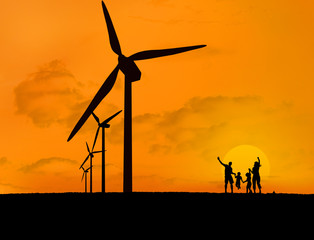 Wind turbines and family with a sunset