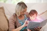 Mother reading storybook with son