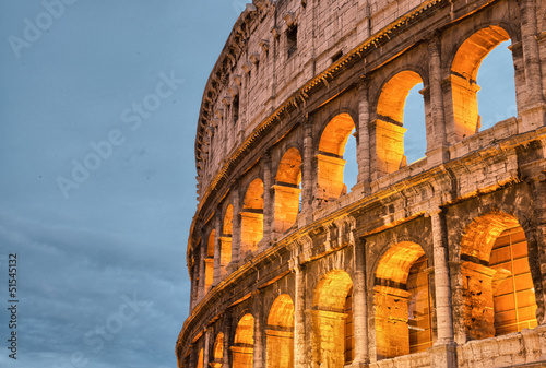 Rome, Italy. Wonderful sunset colors shining on Ancient Colosseu
