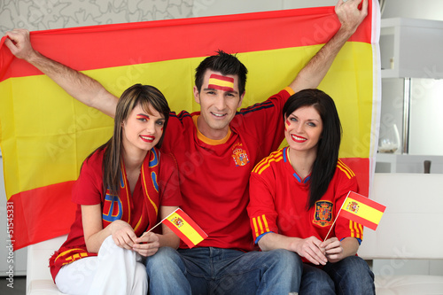 Thee excited Spanish soccer fans