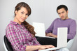 a young couple doing computer