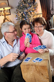Family playing card game at Christmas