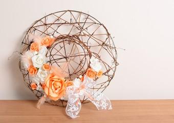 Interior decoration, wreath with orange rose and ribbon.