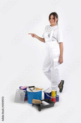 Young female decorator pointing