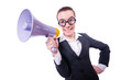 Young businessman with loudspeaker on white