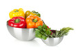 Fresh bell peppers and herbs in bowls