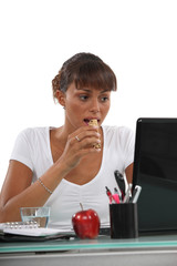 young woman eating a cereal bar