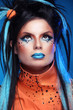 Makeup. Punk Hairstyle. Close up portrait of Rock girl with Blue
