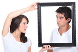 Boy and girl with black frame