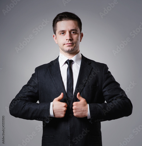 businessman holding two thumbs up