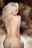 Back of slim blond woman wearing in twinkled crystals lingerie p