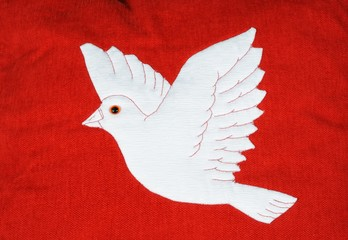 White dove on red fabric © Arena Photo UK