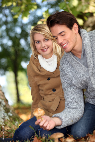 Couple picking mushrooms together