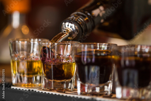 Shots with whisky and liqquor in cocktail bar - 51551755