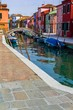 Burano street full of boats and the typical colorful houses