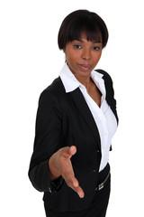 Businesswoman proffering her hand