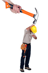 Builder being attacked by giant hammer