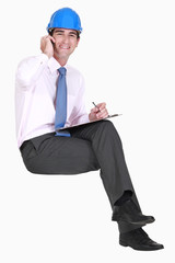 Surveyor sitting on an invisible stool