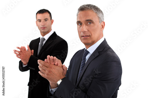 Businessmen rubbing their hands