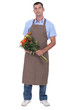 Full length studio shot of a male florist