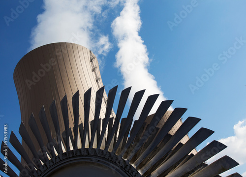 Steam turbine against nuclear power plant and sky
