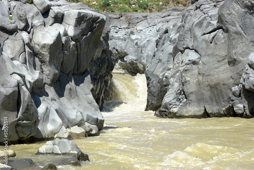 Simeto River And Basaltic Rock
