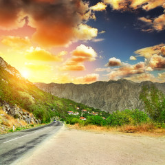 asphalt road with mountians