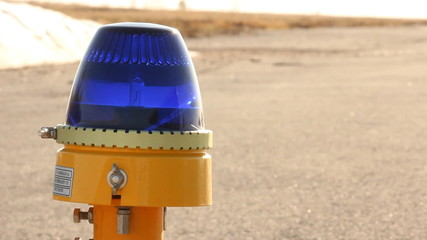 Airport runway. The side taxiway lights blue