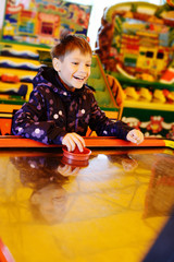 boy playing air hockey game