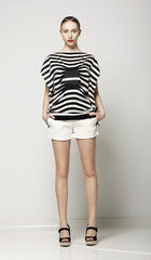 Trendy Woman in Shorts and Striped Shirt. Casual Collection