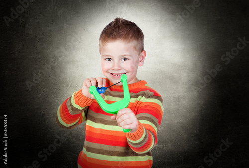 Boy Playing With Slingshot