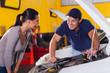 auto technician talking to customer