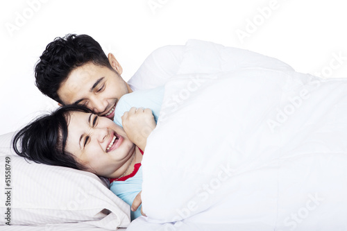 Happy couple on the bed