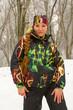 Beautiful woman in ski suit in snowy winter outdoors, Kazakhstan
