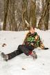 Beautiful woman in ski suit in snowy winter outdoors,  Almaty