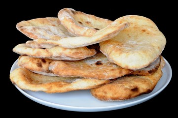 Naan breads stacked on a plate © Arena Photo UK