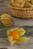 Four physalis on old wooden background