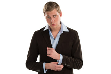 Portrait of a confident young male executive buttoning his cuff