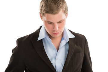 Portrait of a young business man looking away and thinking